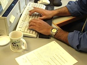 man typling