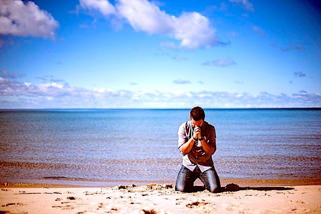 praying on beach